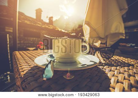 Cup of Tasteful Full Arabica Coffee in the Italian Cafe During Scenic Sunset. Coffee Time.