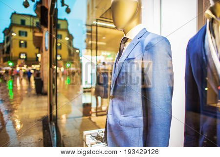Elegant and Expensive Suits Shopping Concept Photo. Glassy Store Front. Shopping Concept.