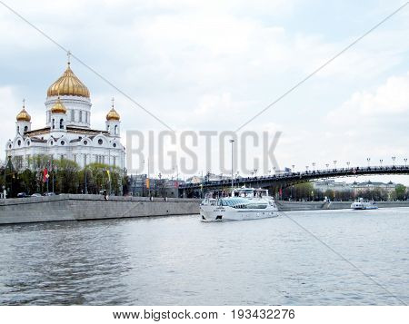 The water-bus on Moscow river near Cathedral of Christ the Saviour in Moscow Russia