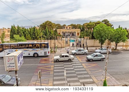 YAZD, IRAN - MAY 5, 2015: Cars passing on Kashani Rd in front of the fire temple Atash Behram in old city.