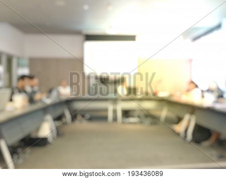 Blurred Image Of Education People Sitting In Meeting Room For Profession Seminar.