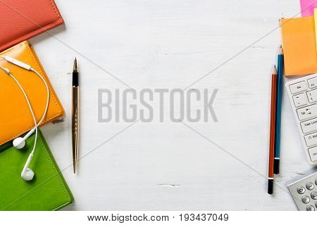 Business workspace table composed with different office stationary staff and copyspace