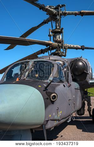 Pushkin, Russia - June 5, 2017: Details of the rotor and part of the body of modern military helicopters closeup. In the foreground the pilot's cabin.