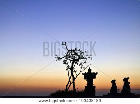 Hindu altar and sunset in Kuta, Bali, Indonesia