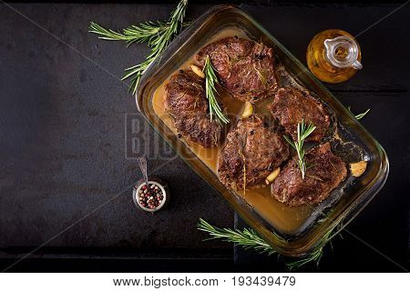 Baked Beef Steak With Garlic And Rosemary. Flat Lay. Top View