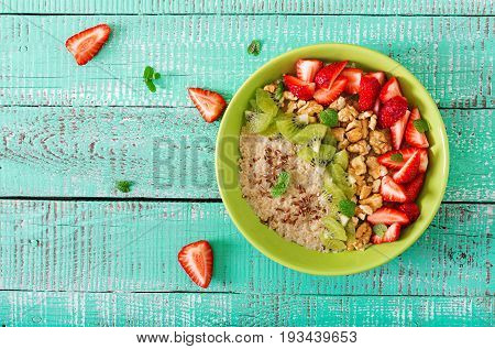 Tasty And Healthy Oatmeal Porridge With Berry, Nuts And Flax Seeds. Healthy Breakfast. Fitness Food.