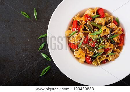 Stir Fry From Chicken Fillet, Green Beans And Paprika With Pasta In The Form Of Heart. Flat Lay. Top