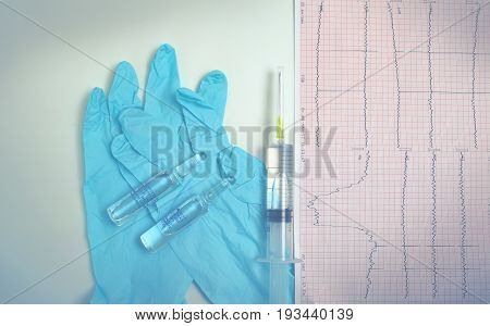 Medical objects on the doctors table. Preparation process for daily routine