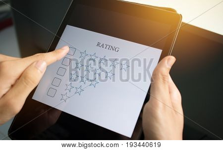 customer survey checking in online survey rating feedback on smart phone with multiple-choice assessment by finger clicking : business concept