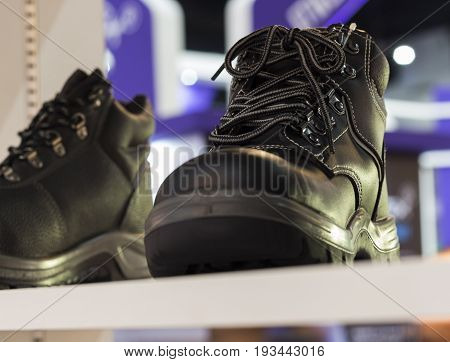 Safety Shoe; protective shoe;Shown on shelf;selective Focus