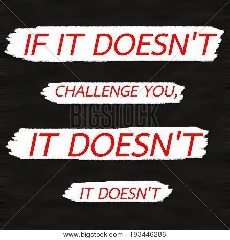 IF IT DOESN'T CHALLENGE YOU IT DOESN'T CHANGE YOU.Creative Inspiring Motivation Quote Concept Red Word On Black wood Background.