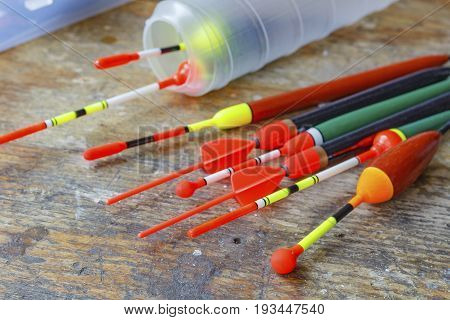 Set Of Fishing Bobbers On A Wooden Table