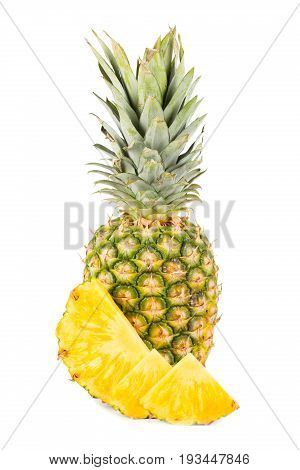 Natural pineapple with cut up pieces and white background