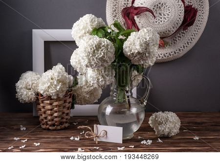 still life with viburnum flowers and white frame