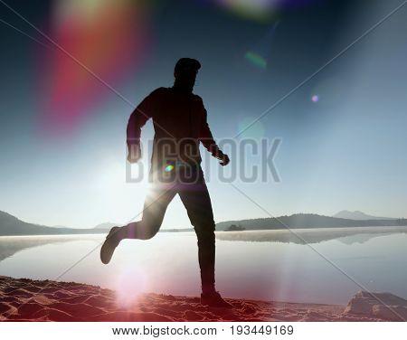 Leakage Of Light In The Lens. . Running Man. Sportsman Run, Jogging Guy During The Sunrise Above San