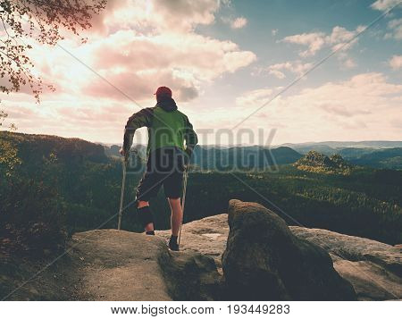 Man With Forearm Crutches. Hiker After Hard Walk Achieved Mountain Peak. Tourist With Broken Leg