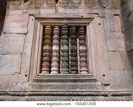 Window balusters made with different colors of stones at Prasat Hin Phanom Rung Ancient Khmer Temple, Buriram, Thailand