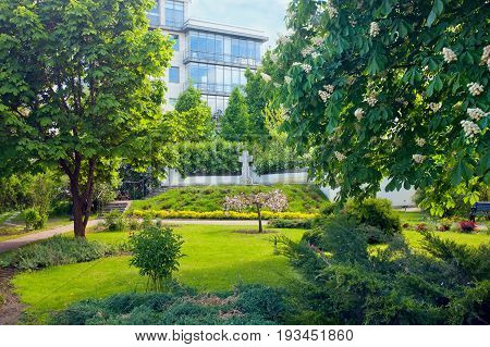 Garden with cross near Marfo-Mariinsky Convent. Moscow Russia.