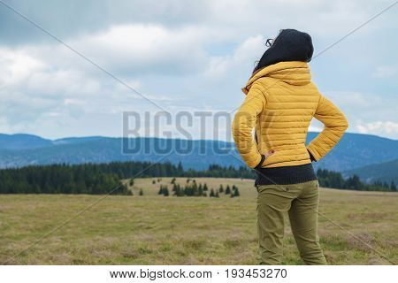 Girl enjoying the view from the top of the hill.