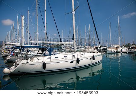 Sailboat harbor, many beautiful moored sail yachts in the sea port, modern water transport, summertime vacation