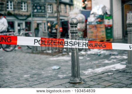 Police tape in Germany at the crime scene with the inscription in German police cordon. Crime Scene Investigation.