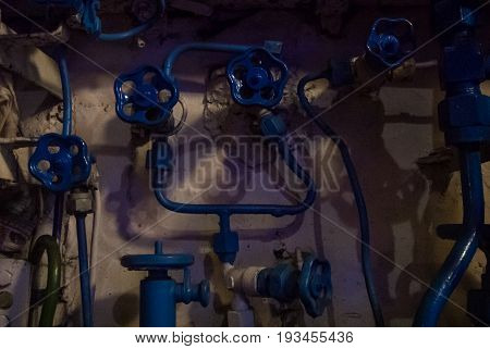 Kaliningrad, Russia - June 12 2017: Close-up View Of Blue Valves And Tubes Of Different Sizes, A Mac