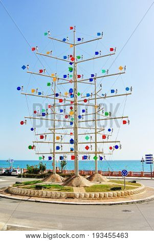 Benalmadena, Spain - February 15, 2014: Benalplaya Roundabout, A Pinwheel In The Street Of Benalmade
