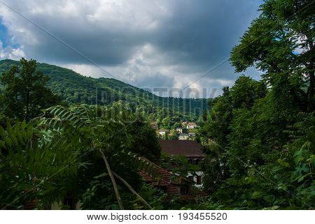Green Mountains Covered With A Forest And Houses, A Natural Green Landscape, Heidelberg, Germany.