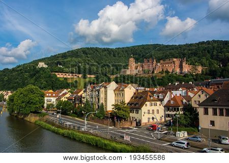 Heidelberg, Germany - June 4, 2017: Panoramic View Of Heidelberg Castle Over The Tile Roofs Of Old T