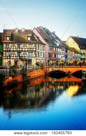 canal scene of Colmar, most famous town of Alsace, France, retro toned