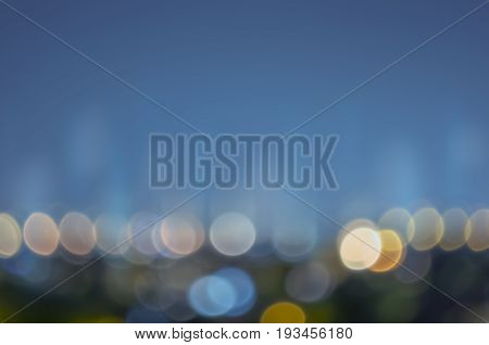 Abstract background city lights at night. Street light blur blue bokeh background. Abstract bokeh orange blue blur lens background.