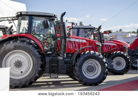 Red large tractor machine for sowing preparation and cultivation of soil for farmers