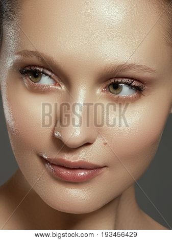 Pretty Girl With Big Eyes And Dark Eyebrows Smiling, A Model With Light Nude Make-up, Gray Studio Ba