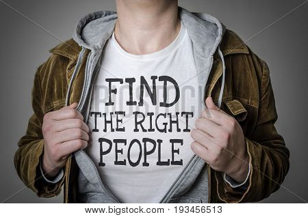 Man showing Find the right people tittle on t-shirt. Human resources partnership choosing partner concept.