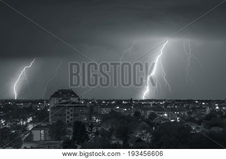 Thunder storm over night city scene background