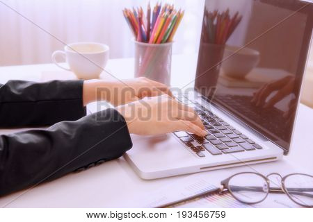 Businesswoman working on the laptop at her modern office.