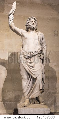 ParisFrance- May 032017: Statue of male deitycalled Jupiter of Smyrna. Collections royales francaises.Louvre