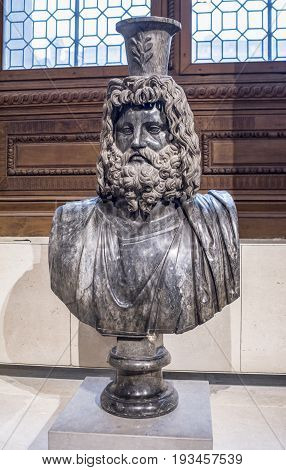 ParisFrance- May 032017: Bust of Serapis. Collections royales francaises.Louvre