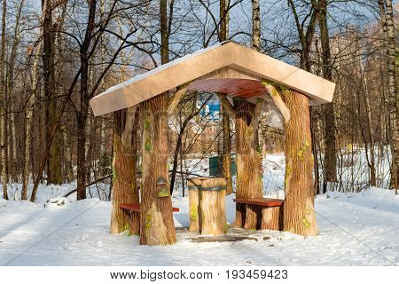 Gazebo in the Russian forest. Pavilion stylized as a trees in a winter park