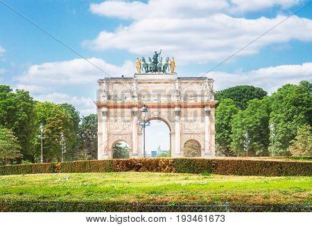 Arc de Triomphe du Carrousel in Tuileries Garden at sunny day, Paris, France, retro toned