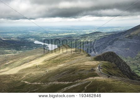 Landscape view from Snowdon towards Llanberis on stormy Spring day