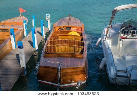 Luxury wooden motor boat at Annecy lake pier. France