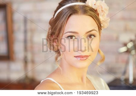 Closeup portrait of young bride in wedding glamour.