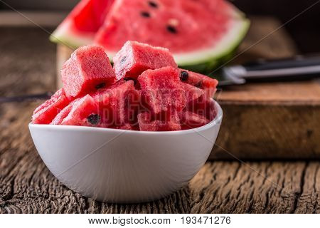 Water melon. Water melon sliced in bowl on wooden table.