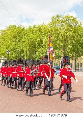LONDON, UNITED KINGDOM - JULY 11, 2012: Soldiers of the Coldstream Guards march down The Mall at the completion of the Changing of the Guard ceremony.