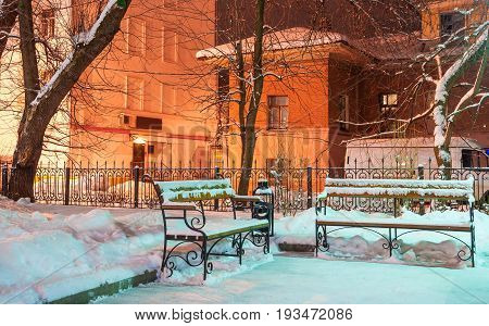 The Evening winter patio with  the benches