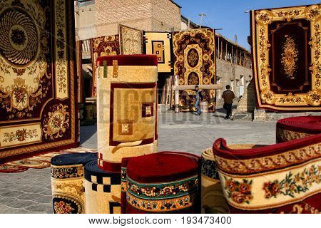 Bukhara UZBEKISTAN - March 08 2009: Sale of carpets on the market in Bukhara