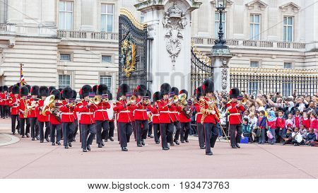 LONDON, UNITED KINGDOM - JULY 11, 2012: The band of the Coldstream Guards marches out of Buckingham Palace during the Changing of the Guard ceremony.