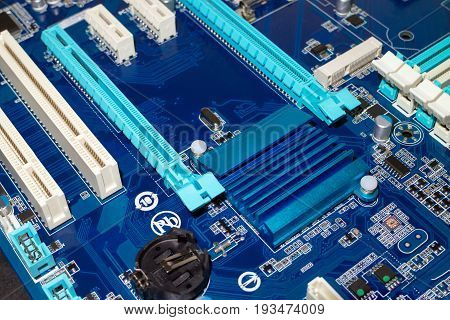 A computer desktop mainboard with electronic components closeup