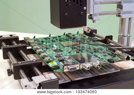 Replacing the microprocessor in bga rework station. Infrared soldering station in operation